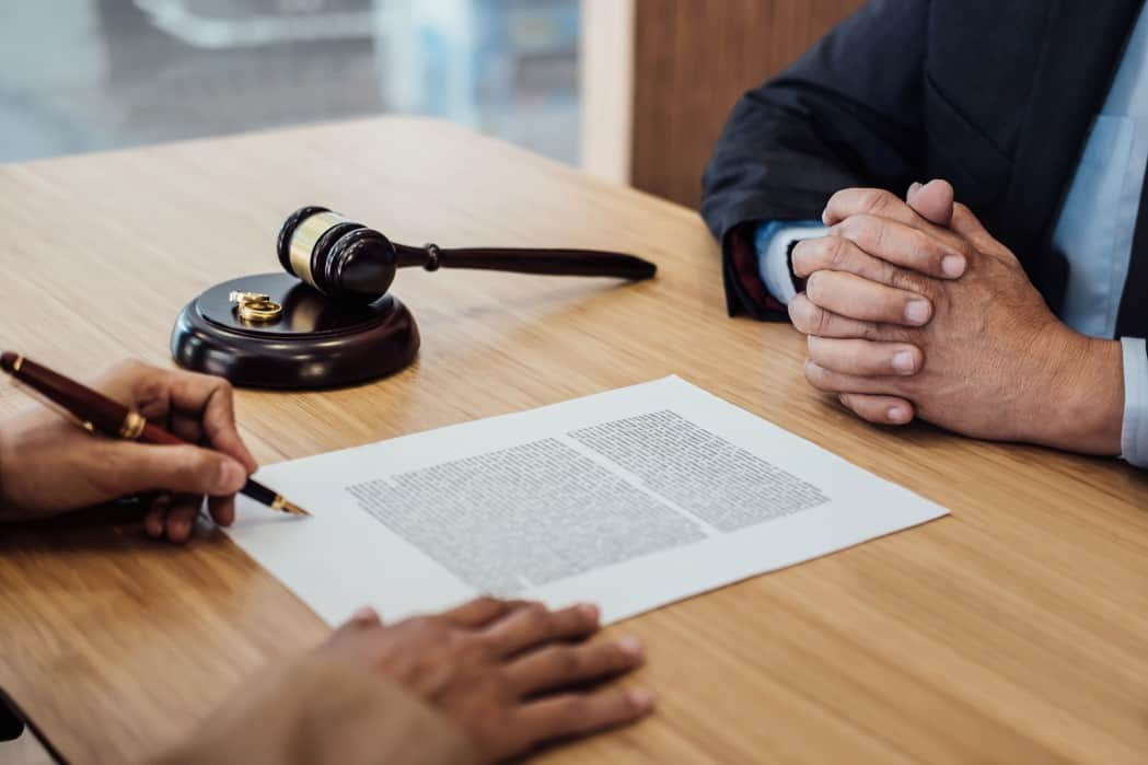 marriage divorce on judge gavel deciding consultation between a businesswoman and male lawyer