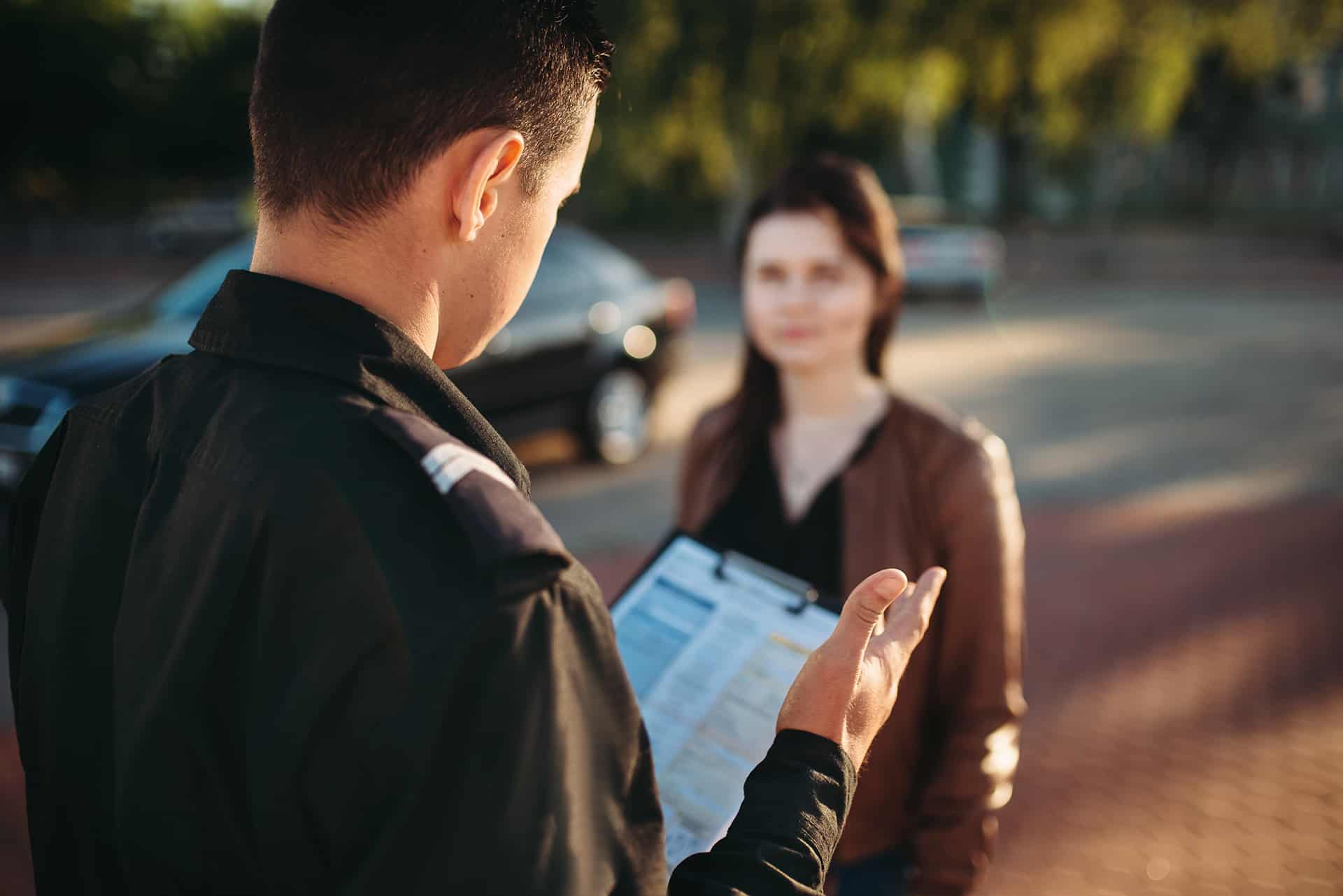Police officer filing a report with a female